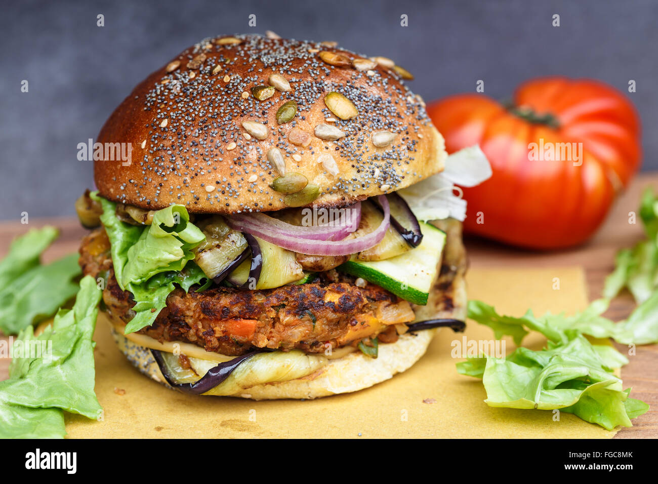 Veggie burger with onion, courgette, aubergine - Stock Image