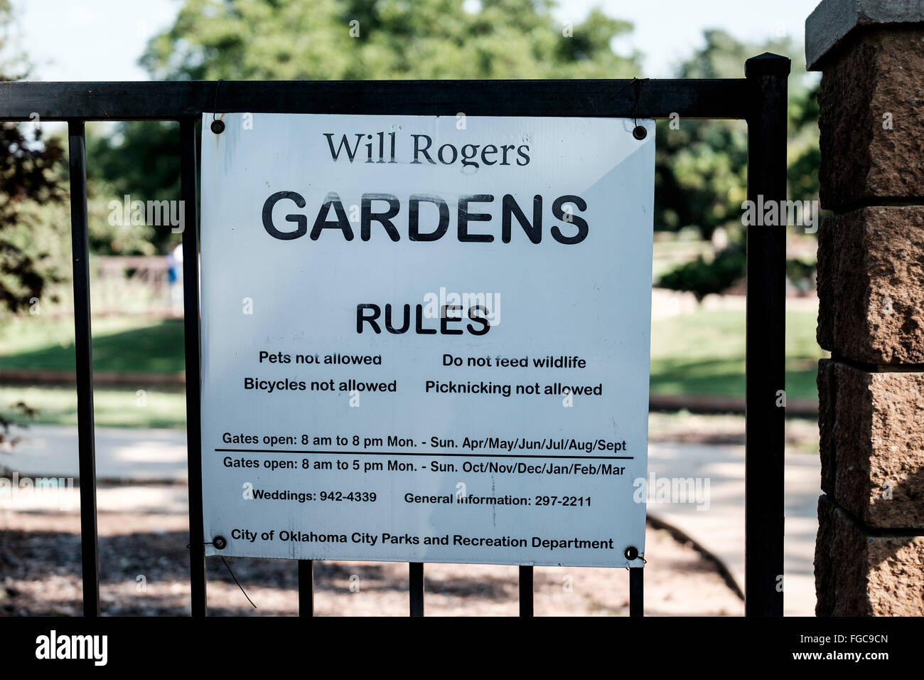 A Will Rogers Gardens Sign On A Wrought Iron Fence In Oklahoma City,  Oklahoma,