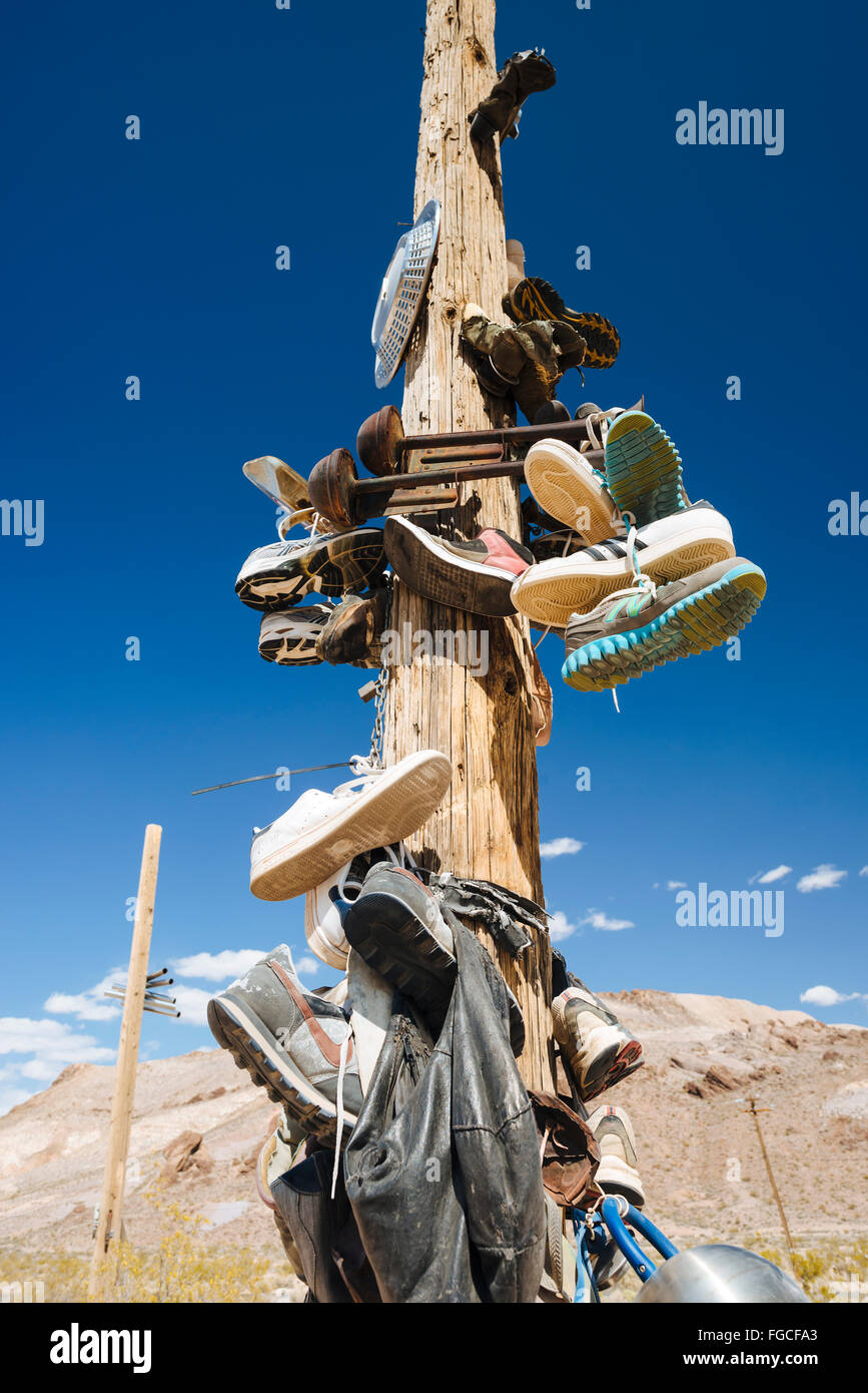 Abandoned shoes strung on a utility pole in Rhyolite, Nevada - Stock Image