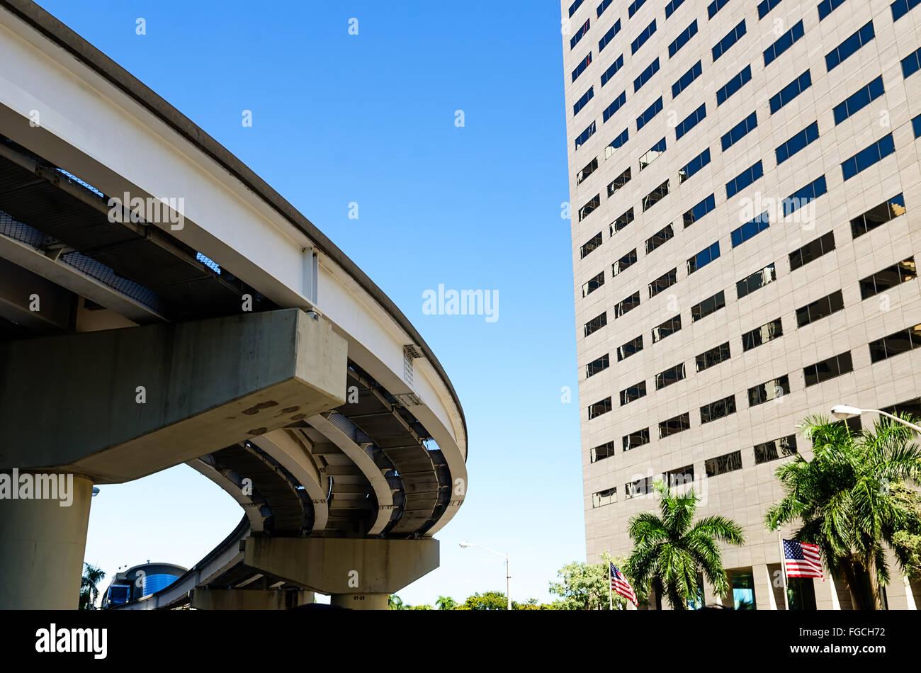 elevated commuter near modern skyscraper building in Miami - Stock Image