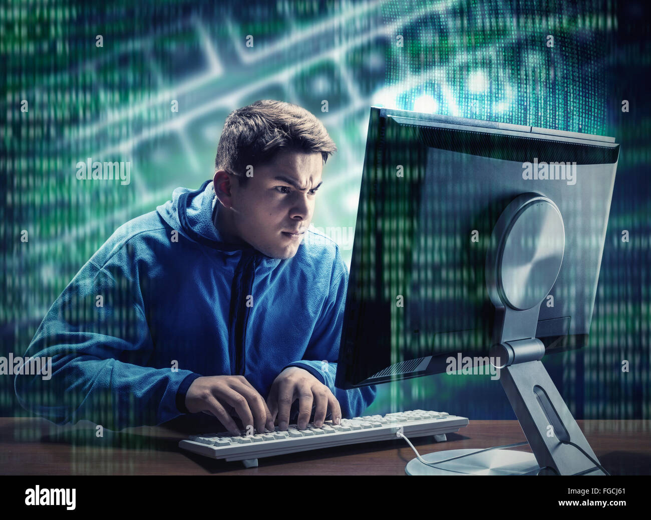 Hacker in the office - Stock Image