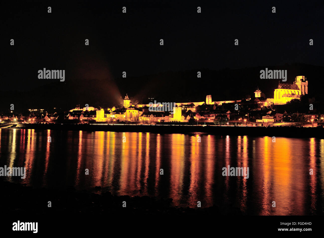 Illuminated town Oberwesel at Rhine bank for the festival of Rhine in Flammen and light reflection, Upper Middle - Stock Image
