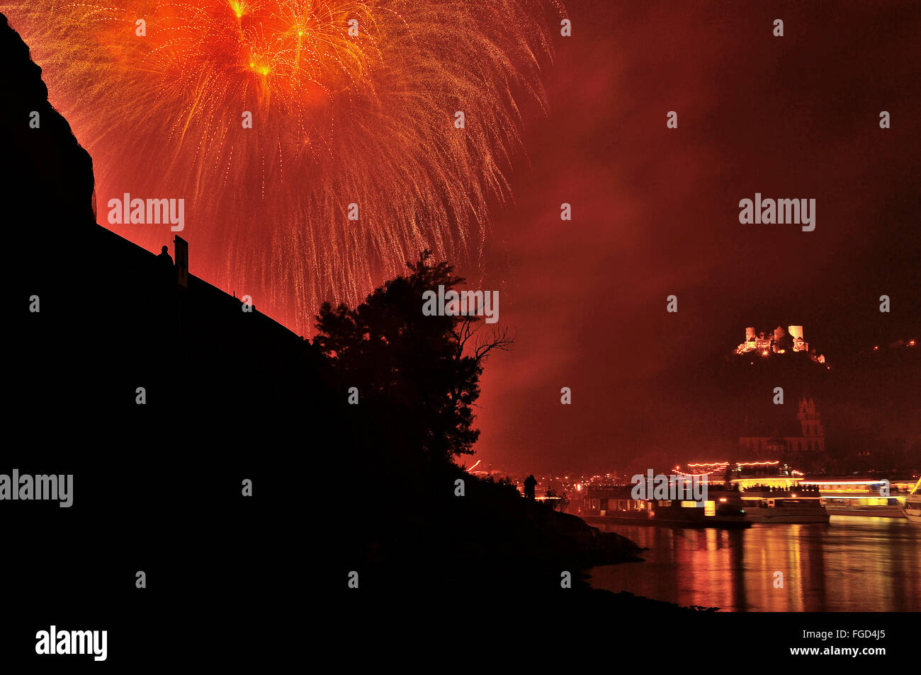 Firework display at town Oberwesel for the festival of Rhein in Flammen, Schönburg Castle, pleasure boats on - Stock Image