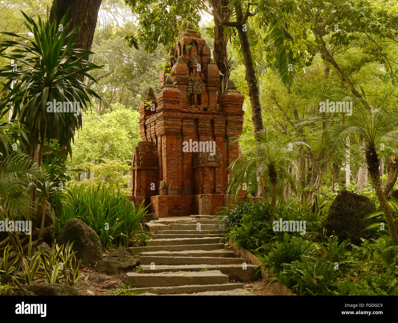 A brick temple in a park in Ho Chi Minh City, Vietnam - Stock Photo