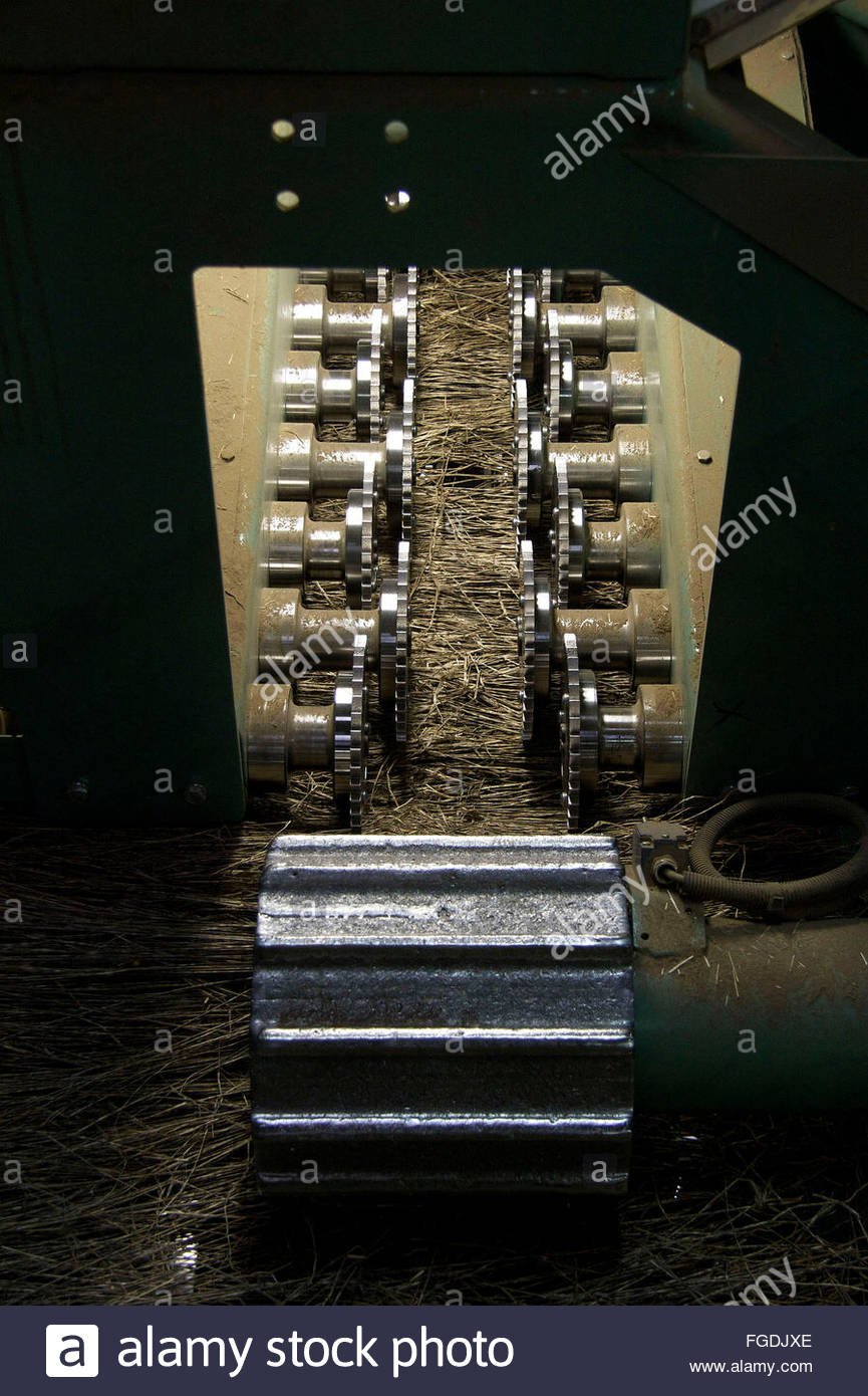 Machinery for grinding the flax on the scutching line, Terre de Lin, Saint Pierre le Viger, Seine Maritime, France - Stock Image