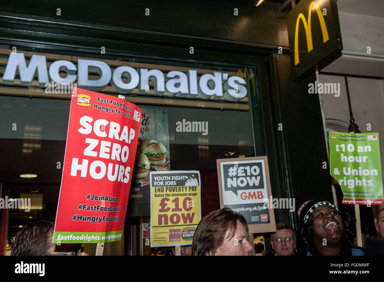 Activists dressed as 'Evil Ronald MacDonald' protesting outside MacDonalds in Whitehall. The campaigners - Stock Image