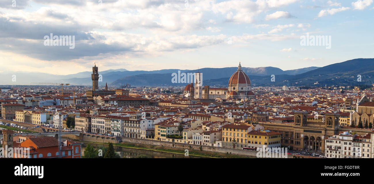 Top view of Florence city with old and historical buildings, on cloudy sunrise or sunset sky background. - Stock Image