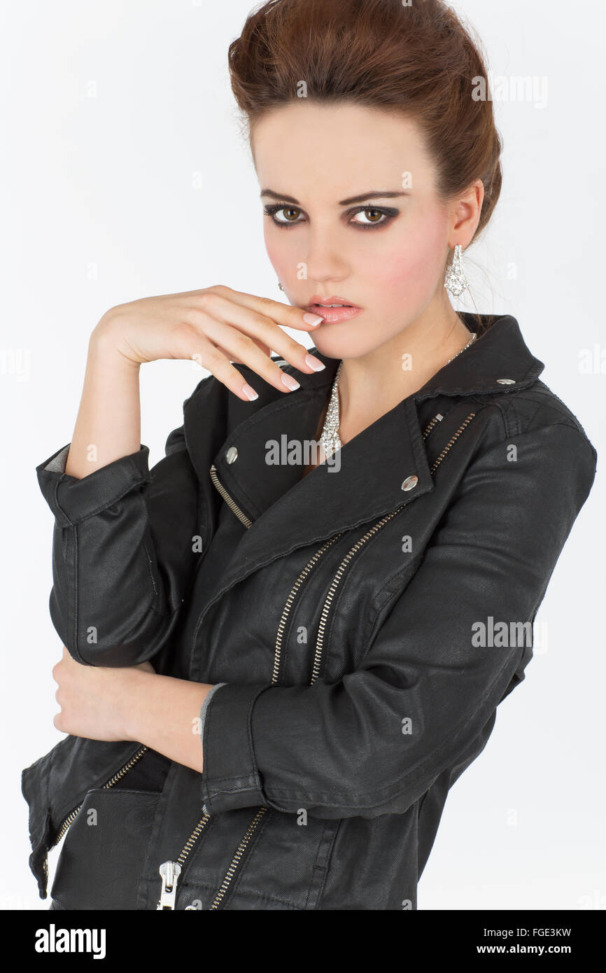 Young woman in leather outfit, Fashion - Stock Image