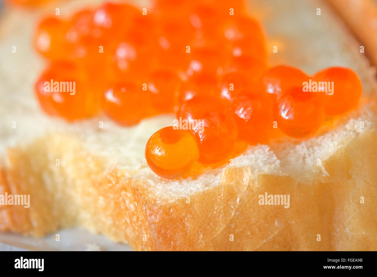 Sandwich of white bread with red caviar Stock Photo