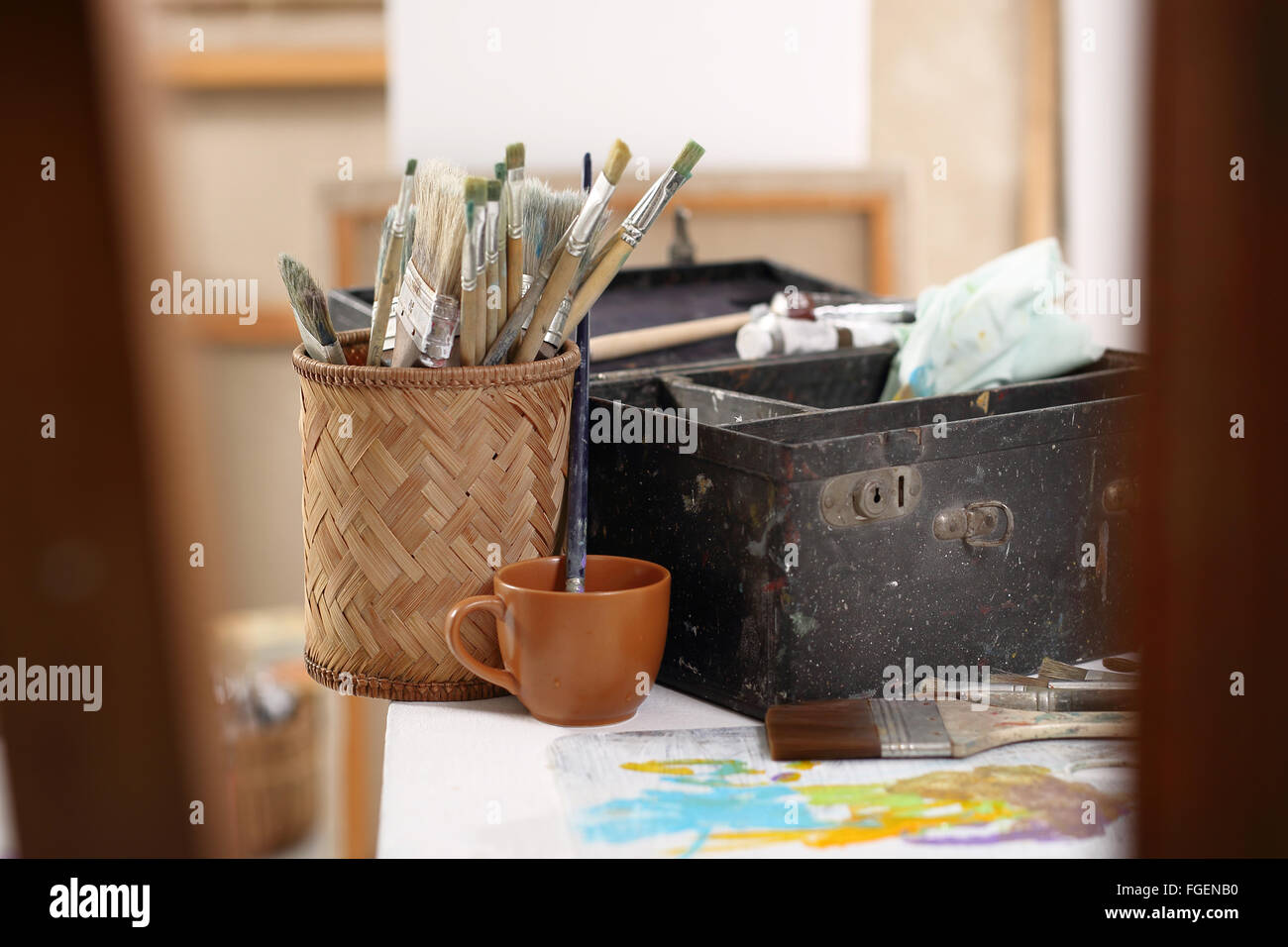 Workshop paint, brushes and paintings. Painting workshop and painting accessories - Stock Image