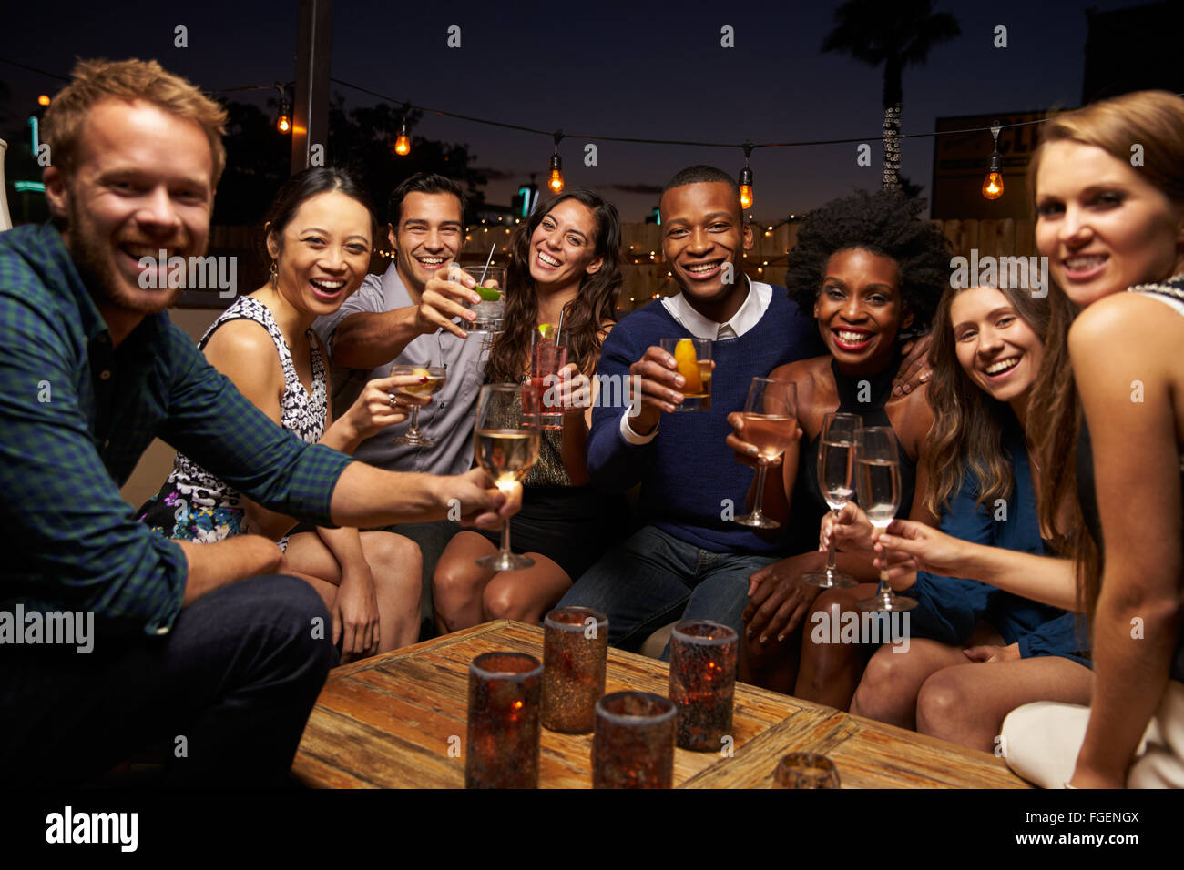 portrait-of-friends-enjoying-night-out-a