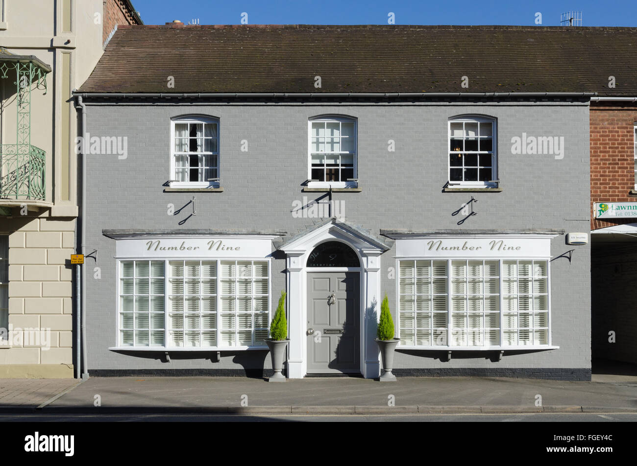 Grey painted house called number nine in pershore worcestershire stock image