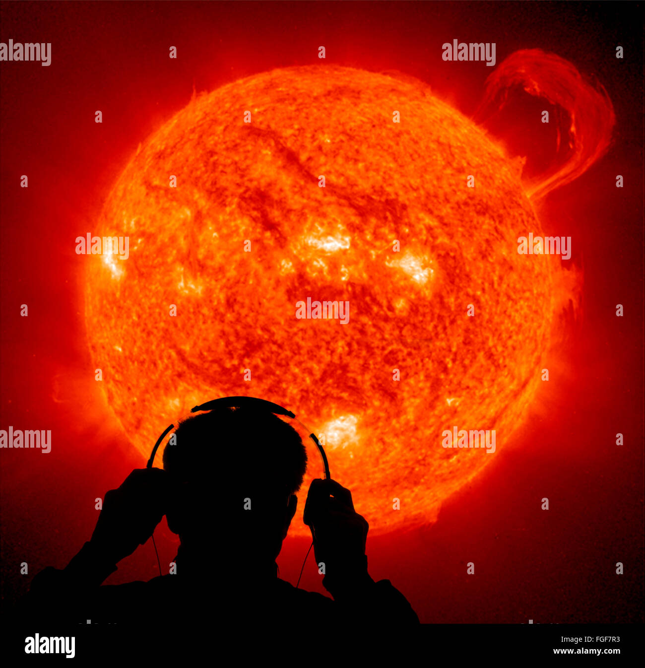 computer generated man listening on sun sounds on head phones - Stock Image
