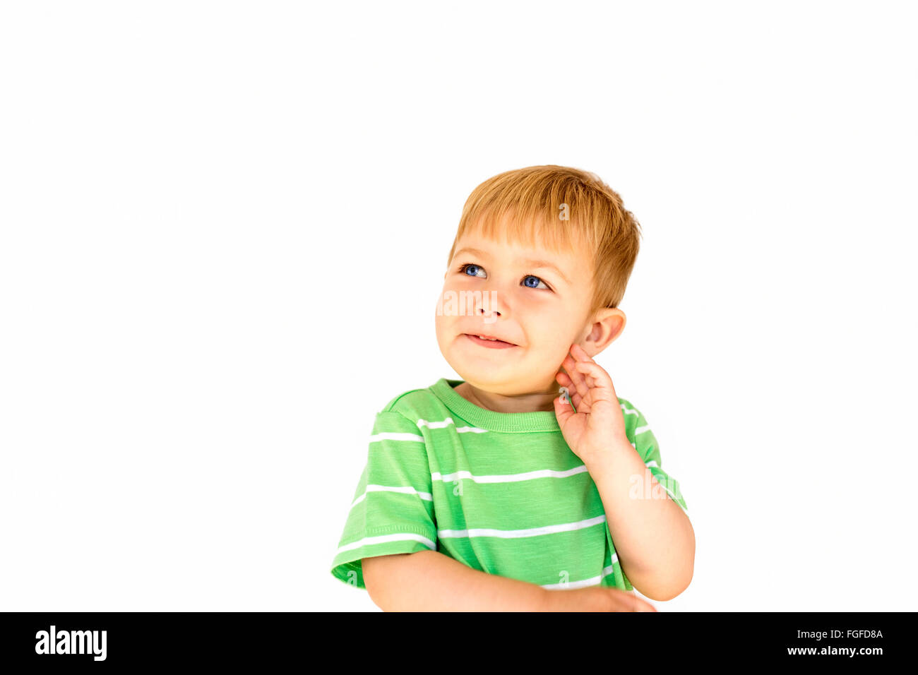 Young boy with blonde hair thinking - Stock Image