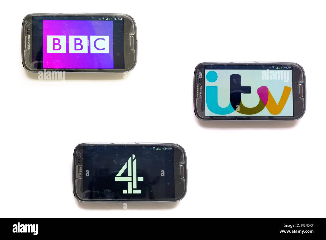 The logos of British TV companies on smartphone screens photographed against a white background. - Stock Image