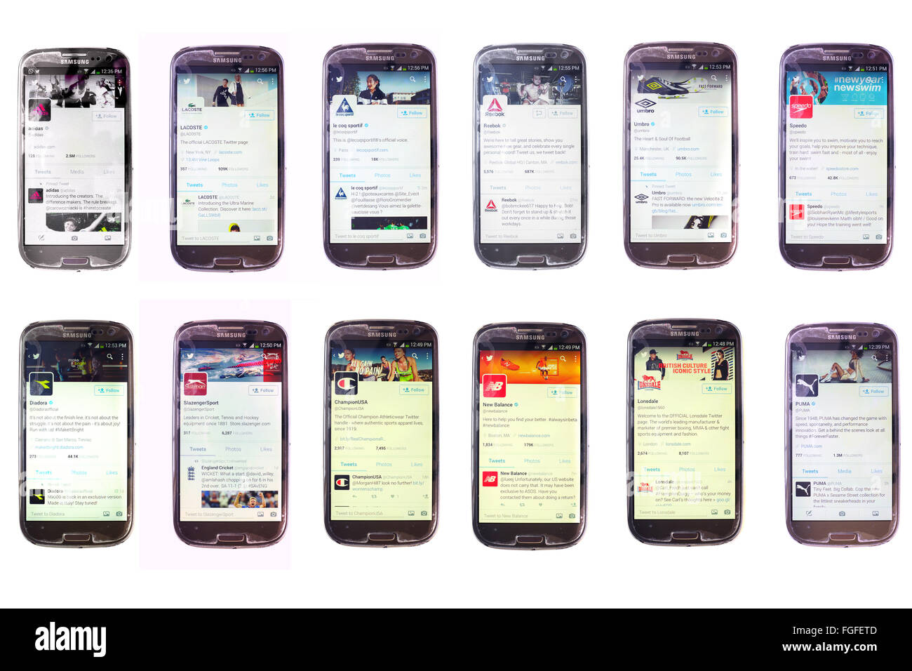 Sports clothing companies twitter accounts on the screens of  smartphones photographed against a white background. - Stock Image