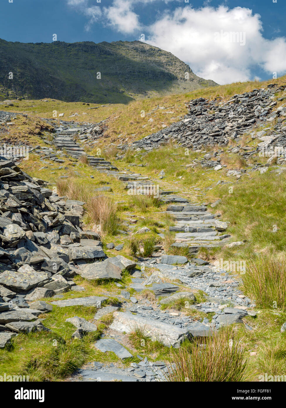 The Watkin path up to the summit of mount Snowdon using a man made path to reduce erosion with the top in view. Stock Photo