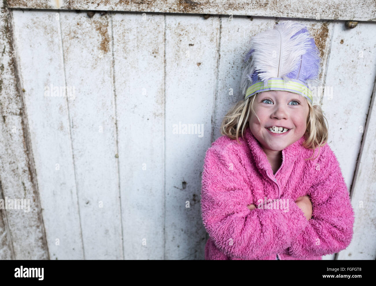 Dress up girl funny face - Stock Image