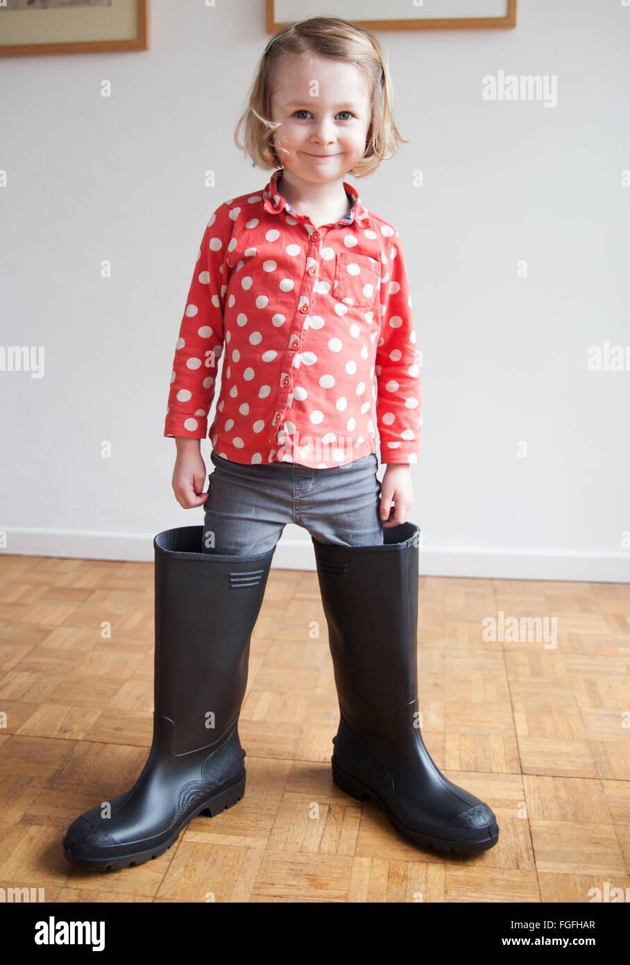 Big boot girl - Stock Image