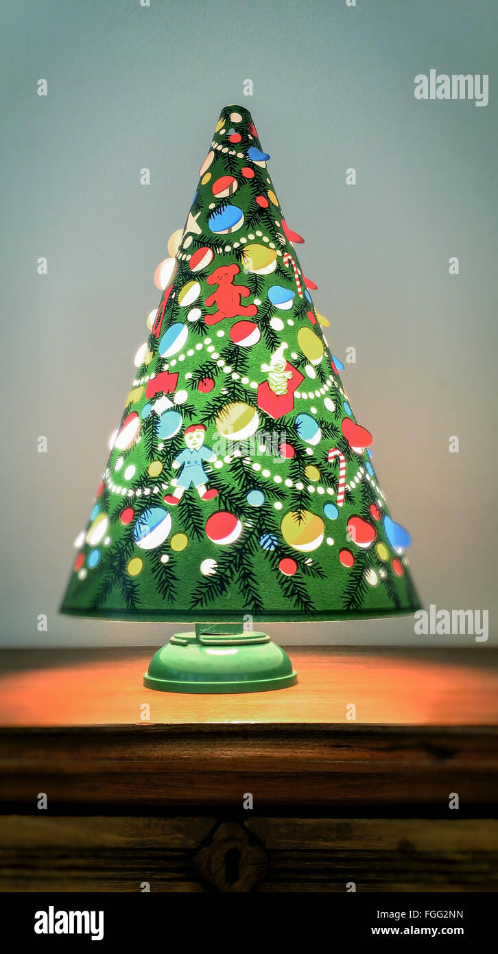 an antique christmas tree lamp spins from the heat given off by the