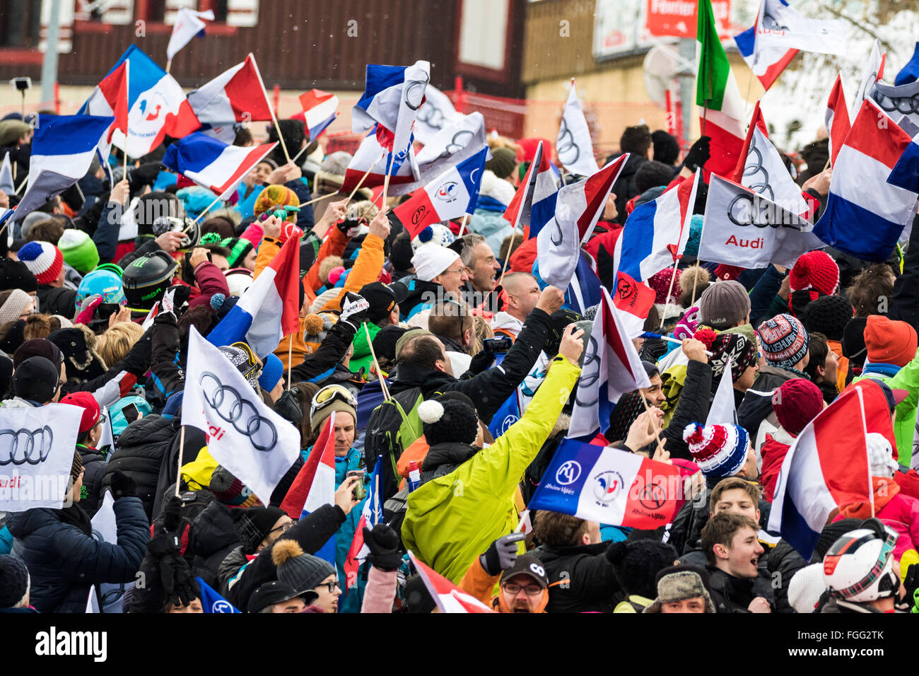 Chamonix, France. 19th February, 2016. Fans react to the arrival of Alexis Pinterault at the finish of the men's - Stock Image