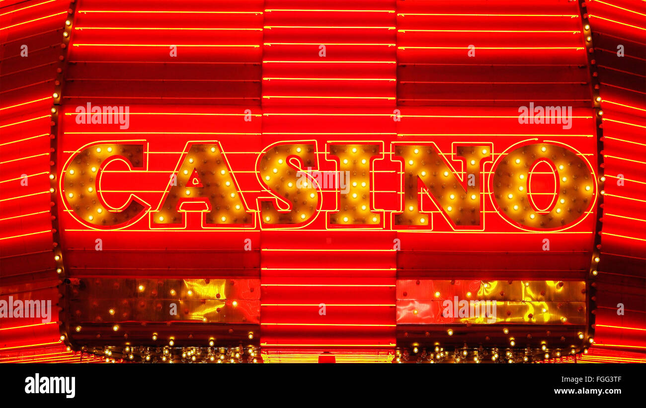 The word casino is lit up in neon lights at night on Freemont Street in Las Vegas - Stock Image