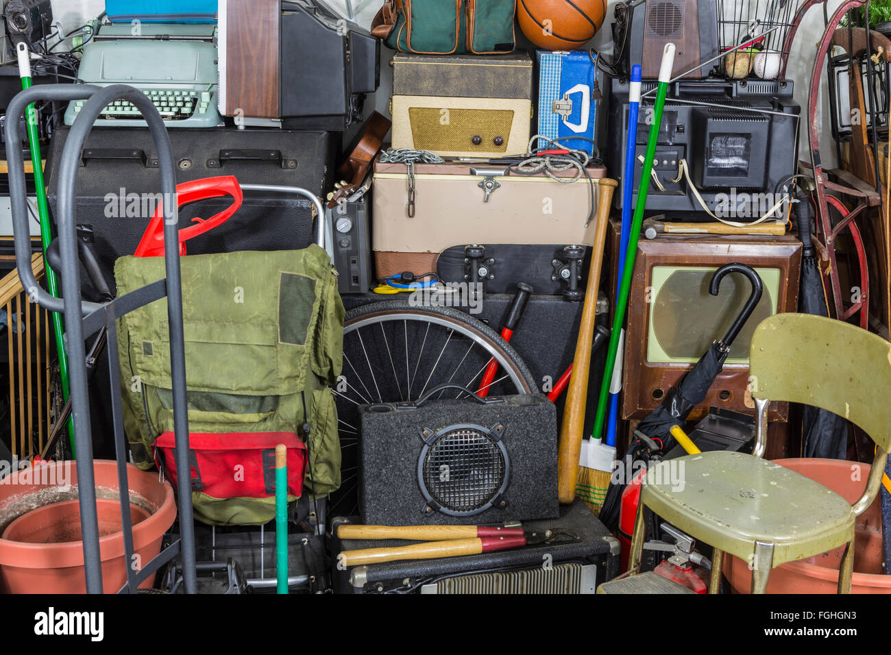 Vintage rummage junk pile storage area mess. - Stock Image