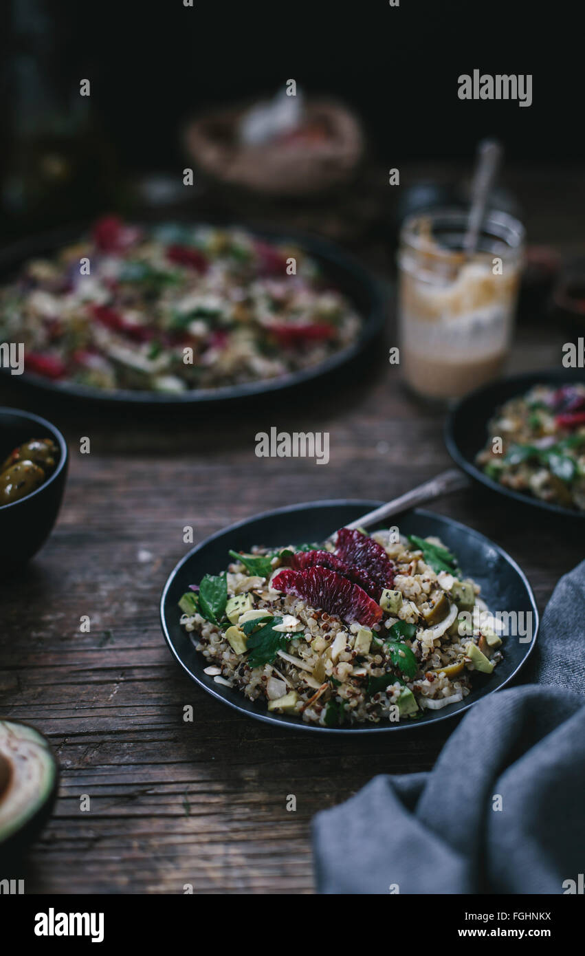 A one-person portion of the Avocado and Quinoa salad with blood oranges and fennel is photographed from the front. - Stock Image