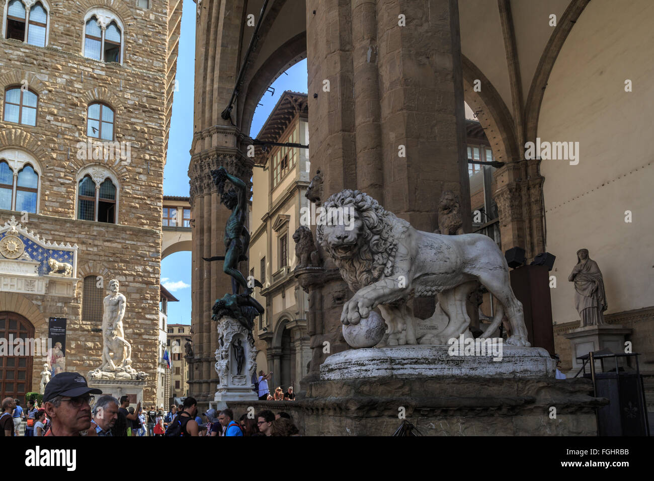 FLORENCE, ITALY - SEPTEMBER 22, 2015 : View of Lion sculpture at Piazza Della Signoria in Florence, with people - Stock Image