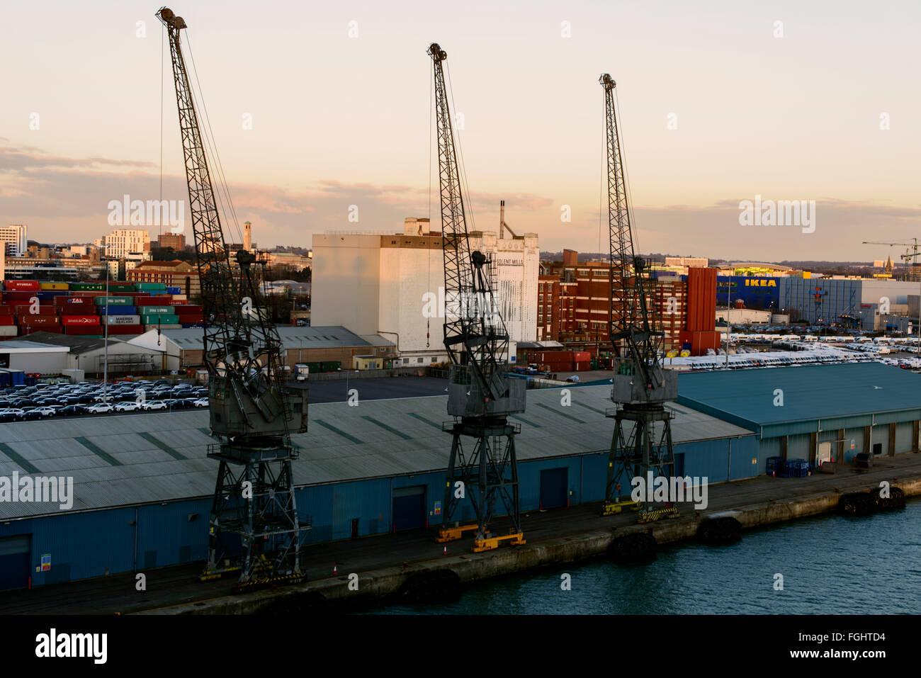 Cranes at Southampton docks in the evening - Stock Image