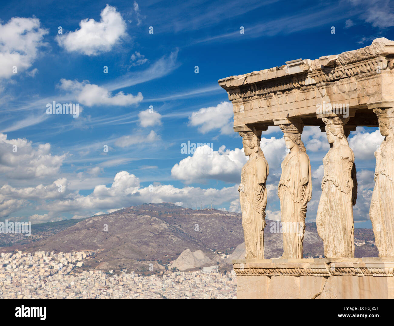 Athens - The statues of Erechtheion on Acropolis and the town in morning light. Stock Photo