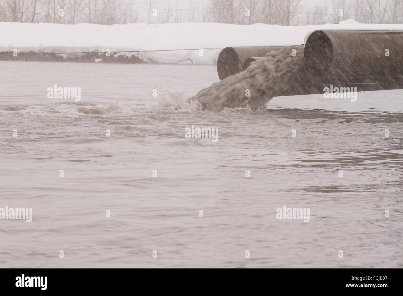 Dirty water discharged into the river, pollution Stock Photo