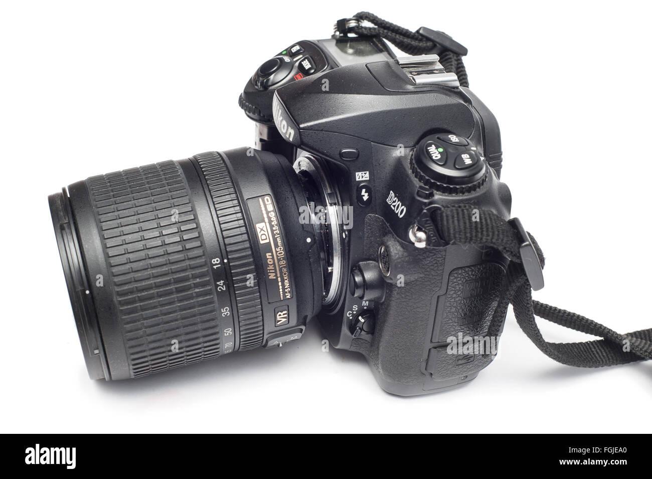 Pavlograd, Donetsk - Januart 27, 2015: Broken Nikon D200 DSLR Camera with 18-105 Nikkor Lens. Isolated on white - Stock Image