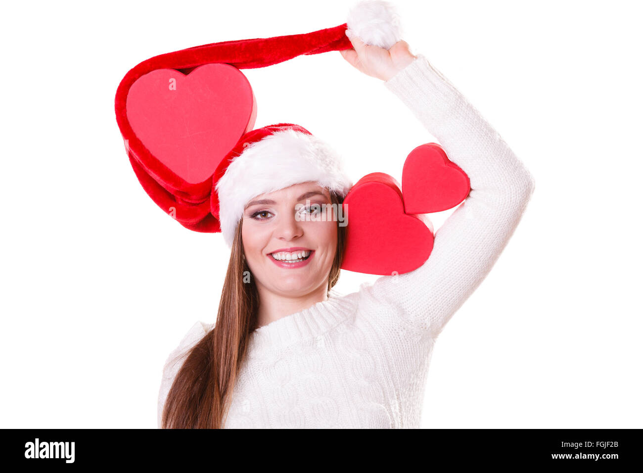 Happy smiling woman in santa hat holding red heart box present. Christmas  winter time. 69b170ee581