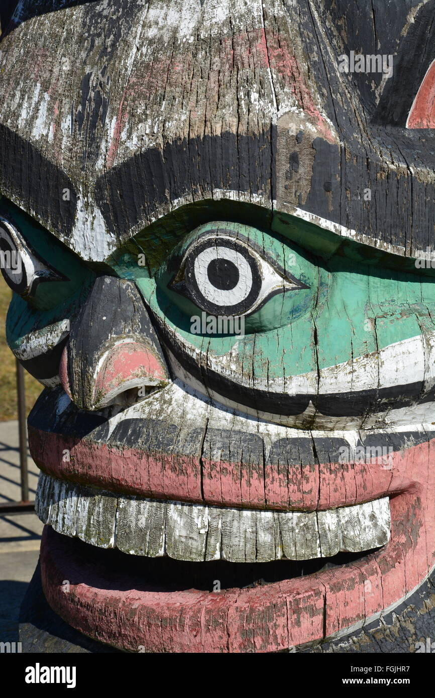 2016 Close up of the weathered grimacing sea monster at the base of the Kwanusila Totem Pole located in Chicago's - Stock Image
