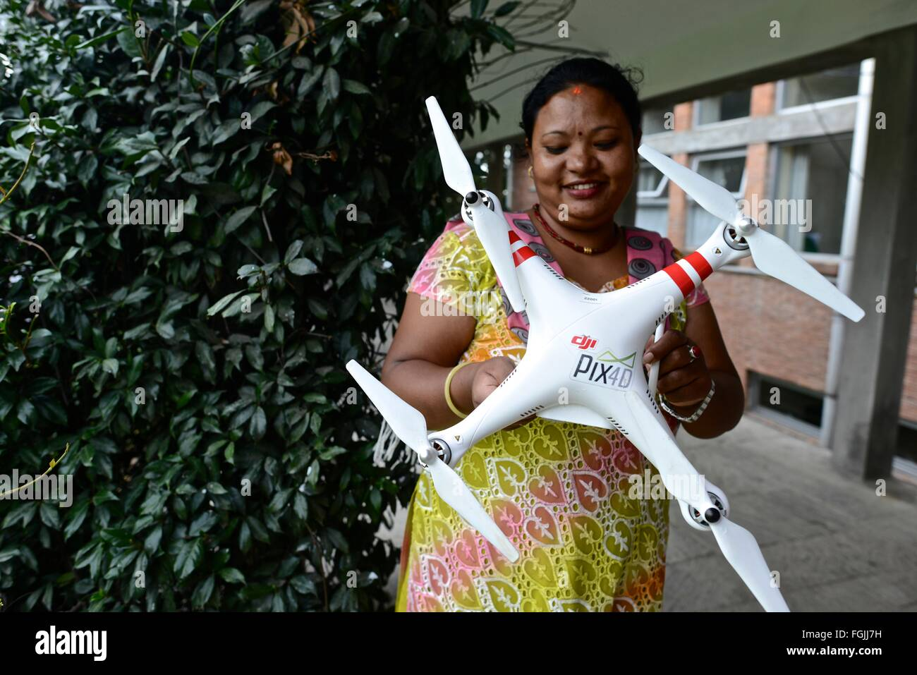 Nepali woman learning the basics of drone at a workshop in Kathmandu - Stock Image