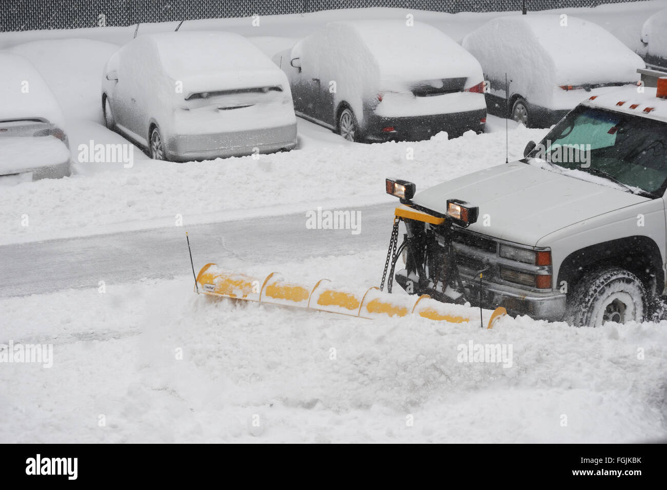 snowplow removing snow on the street after blizzard - Stock Image