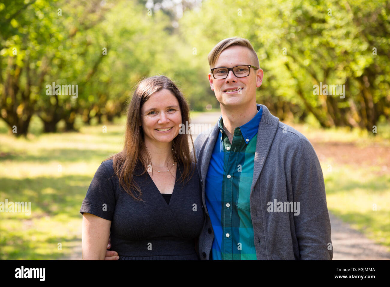 Lifestyle portrait of a happy couple outdoors with natural light. Stock Photo