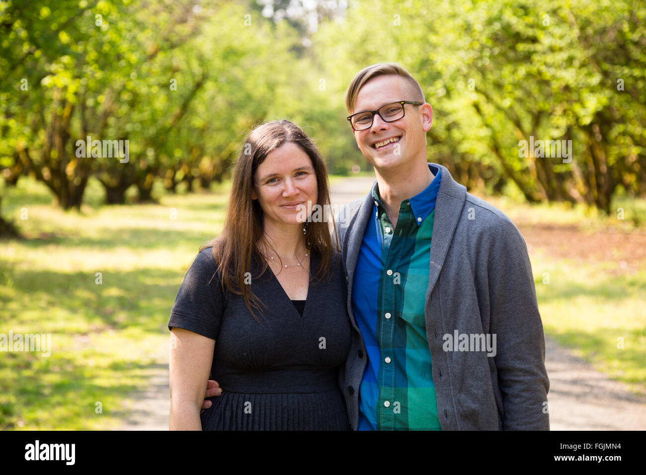 Lifestyle portrait of a happy couple outdoors with natural light. - Stock Image