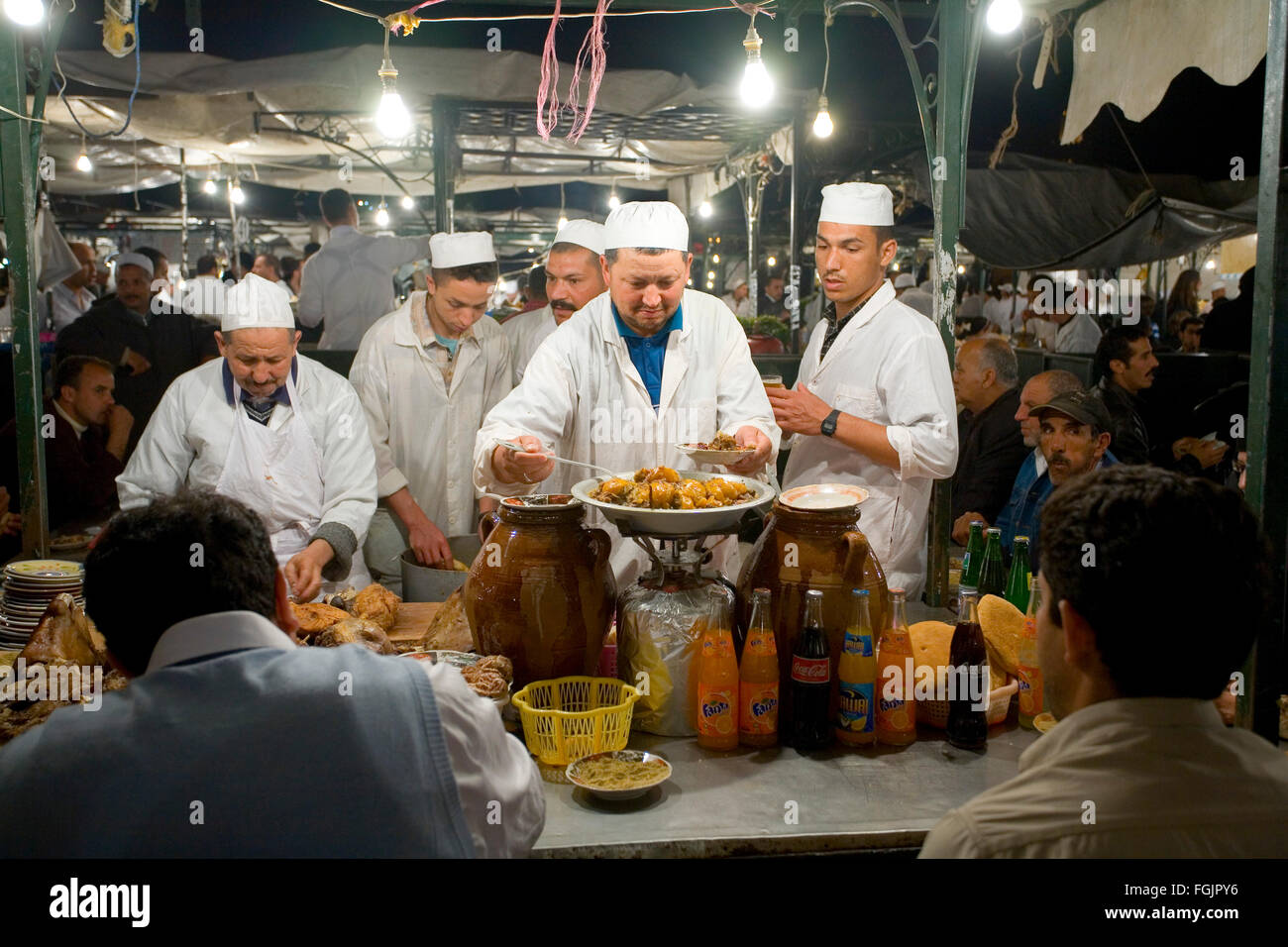Chefs cooking food in Jemaa El Fna Square in Marrakech Morocco - Stock Image