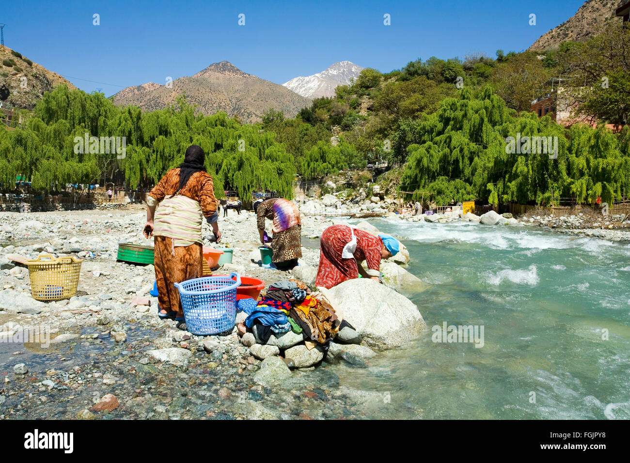 Washing clothes in the river at Setti Fatma, Ourika Valley Morocco - Stock Image