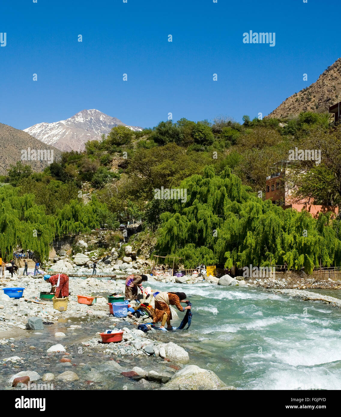 Washing Clothes in the river at Setti Fatma,  Ourika Valley, Morocco near Marrakech - Stock Image