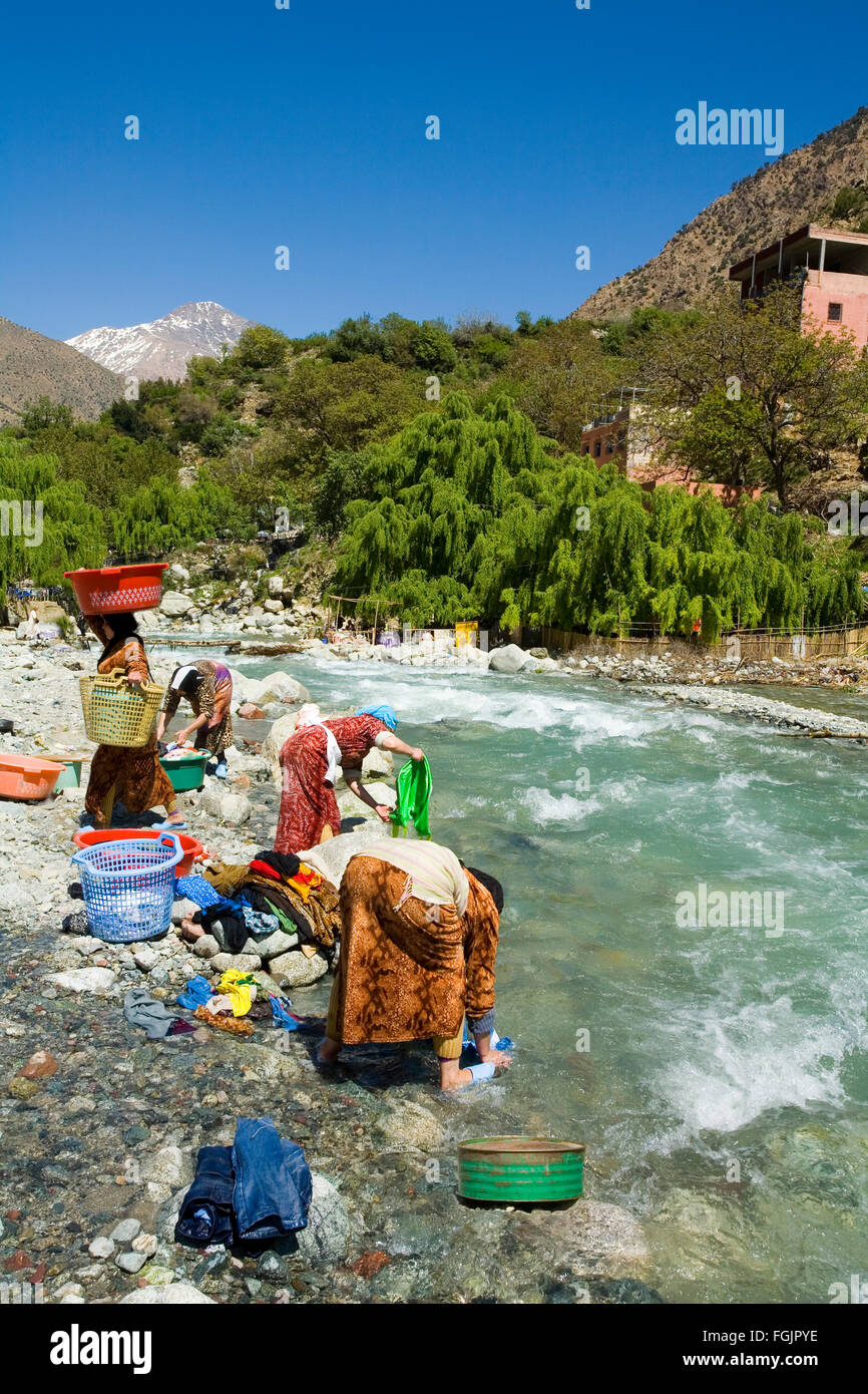 Washing clothes in the river at Setti Fatma, Ourika valley Marrakech Morocco - Stock Image