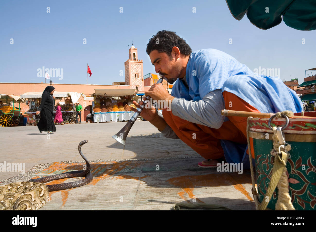 Snake Charmer  in Jemaa El Fna Square in Marrakech - Stock Image