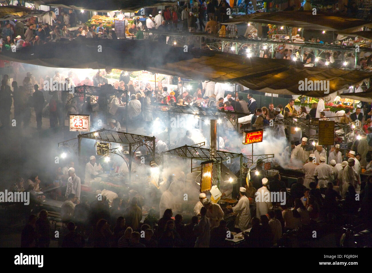 Eating out in Jemaa El Fna Square in Marrakech Morocco - Stock Image