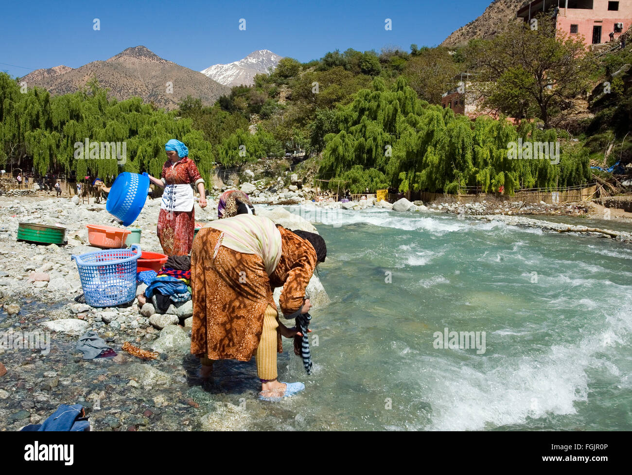 Washing day at the village of Setti Fatma, springtime in the Ourika Valley, Morocco near Marrakech - Stock Image