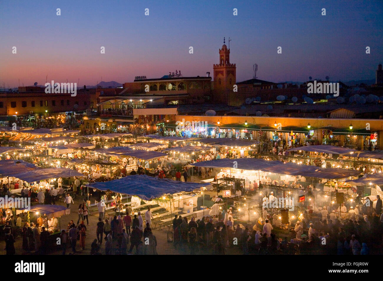 Evening cafes and stalls in Jemaa El Fna Square. Marrakech, Morocco - Stock Image