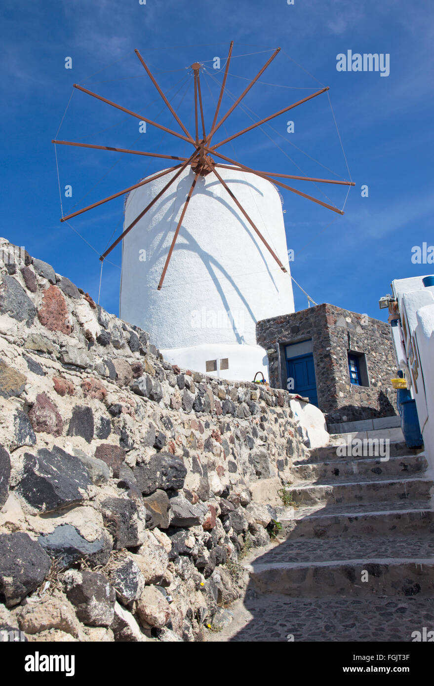 Santorini - The ailse and windmill in Oia. - Stock Image