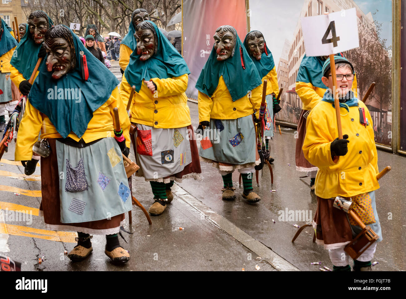 frightening witches under rain at Carnival parade, Stuttgart - Stock Image