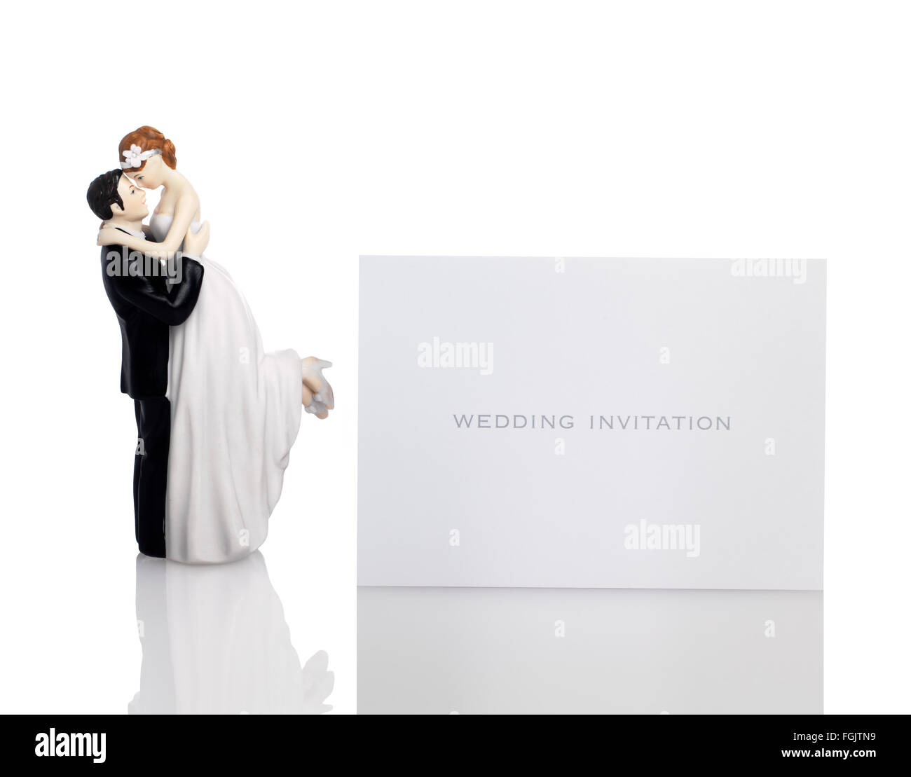 Bride and Groom with a wedding invitation - Stock Image